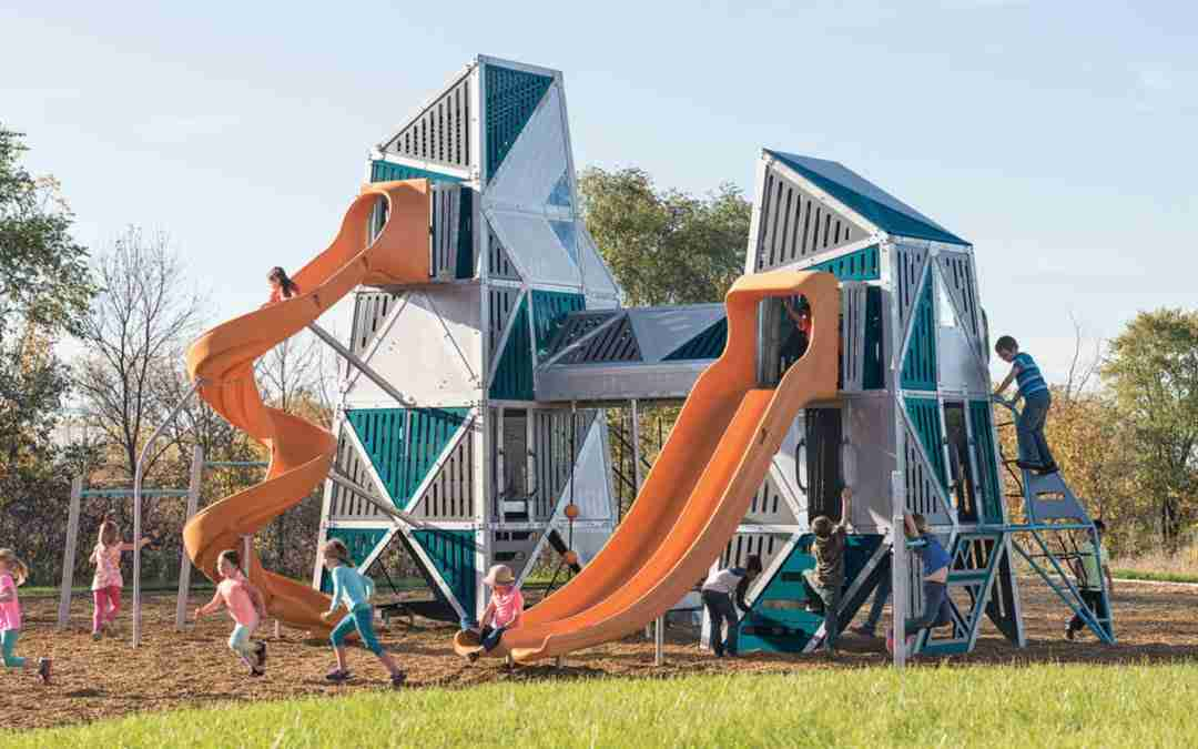 children playing on 2-story playground equipment with slides
